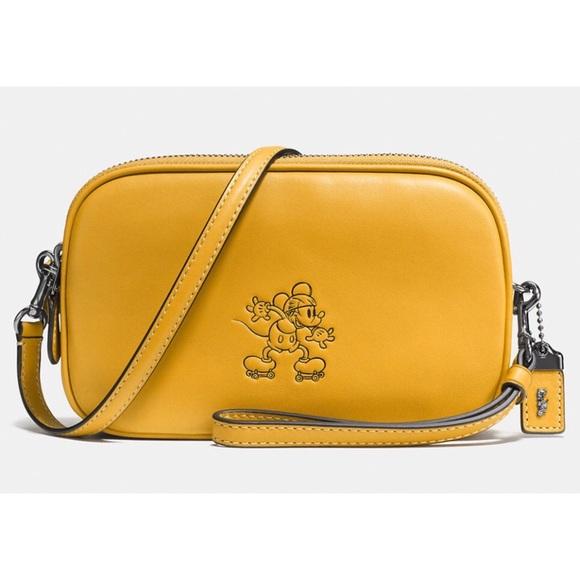 0eb23b3929b9 Coach Handbags - Disney x Coach Yellow Mickey Crossbody Clutch